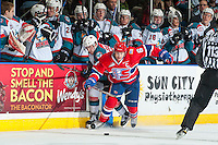 KELOWNA, CANADA - JANUARY 4: Tyson Helgesen #6 of the Spokane Chiefs checks Rodney Southam #17 of the Kelowna Rockets in to the boards during second period  on January 4, 2017 at Prospera Place in Kelowna, British Columbia, Canada.  (Photo by Marissa Baecker/Shoot the Breeze)  *** Local Caption ***