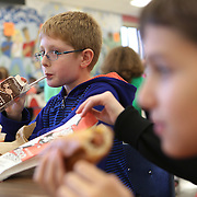 Joshua (L) Mathew Sherman (R) at the peanut free table lunch at Meridian Middle School Monday, November 19, 2013 in Buffalo Grove, Ill.<br />