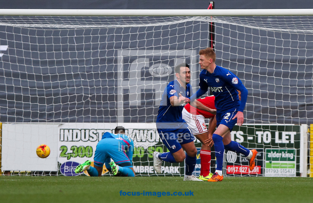 Sam Clucas (right) of Chesterfield scores his sides first goal during the Sky Bet League 1 match at the County Ground, Swindon<br /> Picture by Tom Smith/Focus Images Ltd 07545141164<br /> 17/01/2015