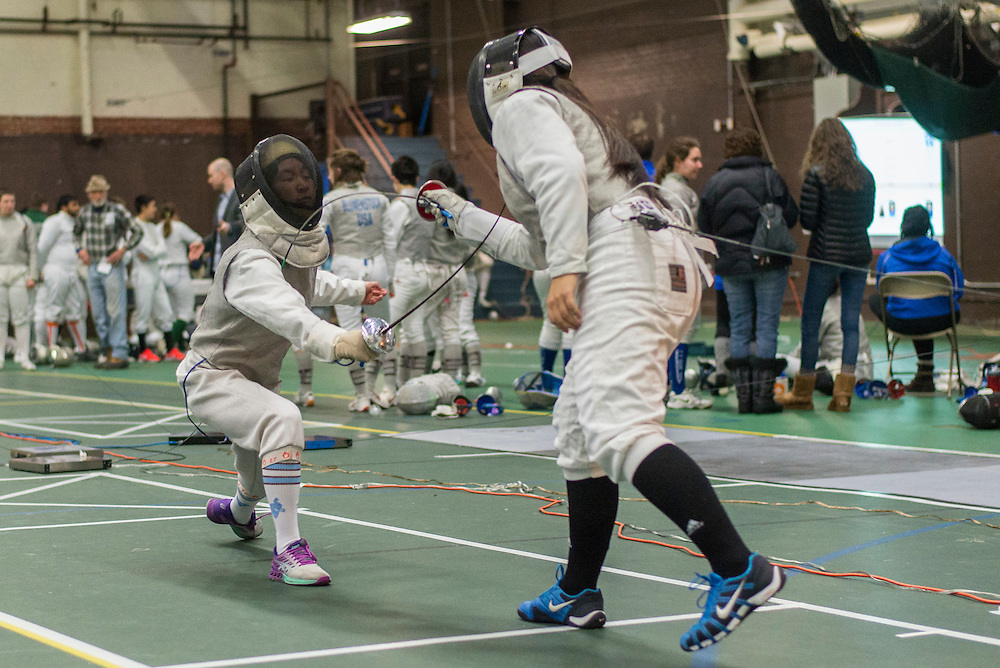 2/11/17 - Medford/Somerville, MA - First-year foil Kaiyue Lu in a match against B.U. at the Tufts Multi-Meet in Cousens Gym on Feb 11, 2017. (Ray Bernoff / The Tufts Daily)