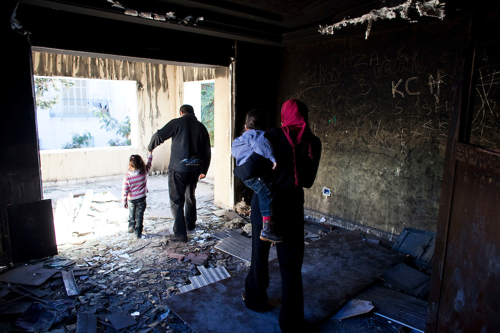 Gammarth, Tunisia. January 29th 2011.The destroyed and burned house of the first and ex wife of Belhassen Trabelsi who is Leila Trabelsi's older brother..People walked around the house with family and friends.....