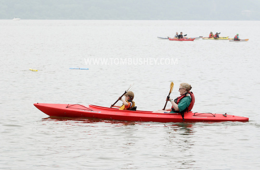 New Windsor, New York - A woman and a child kayak in the Hudson River at the Paddlefest event sponsored by the Mid-Hudson Chapter of the Adirondack Mountain Club at Kowawese Unique Area at Plum Point on  Sunday, June 13, 2010.