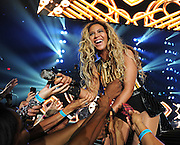 """Singer Beyonce performs on her """"Mrs. Carter Show World Tour 2013"""", on Saturday June 29, 2013, in Las Vegas, Nevada. (Photo by Frank Micelotta/Invision for Parkwood Entertainment/AP Images)"""