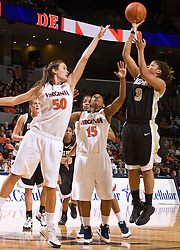 Wake Forest guard Camille Collier (3) is challenged by Virginia forward Chelsea Shine (50) on a jump shot.  The #15 ranked Virginia Cavaliers defeated the Wake Forest Demon Deacons 77-59 in NCAA Women's Basketball at the John Paul Jones Arena on the Grounds of the University of Virginia in Charlottesville, VA on January 11, 2009.