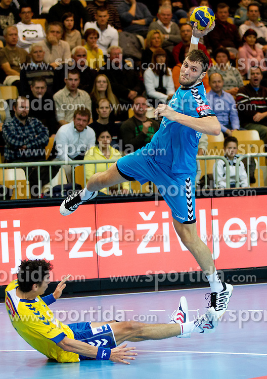 Jure Dobelsek of Cimos Koper and Nikita Samarskiy of Petersburg during handball match between RK Cimos Koper (SLO) and Sankt Petersburg HC (RUS) of 6th Round of EHF Champions League 2011/12, on November 26, 2011, in Arena Bonifika, Koper, Slovenia. Cimos Koper defeated Sankt Petersburg 30-23. (Photo by Vid Ponikvar / Sportida.com)
