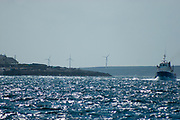"Windfarm on Inishmore, Aran Islands, Ireland. The Aran Islands are amongst 26 EU islands which officially launched their clean energy transition  in February 2019. The Aran Islands are dependent on expensive and polluting fuels for electricity production, heating and transport, and is connected to the national grid. A fault in the line in 2016 underlined  the islands' energy dependency which re-ignited conversation about carbon-neutrality and renewable energy generation.<br /> <br /> ""The objective of the Clean Energy for EU Islands Secretariat is to help as many European islands as possible embark on and advance their clean energy transition in a way that includes the whole island and its stakeholders. Based on experience with successful transition processes, the key to success is to involve all levels of governance of the islands - citizens, municipalities, local businesses, universities and schools – as well as relevant stakeholders from the mainland and bring them on board to actively support and shape their own transition.""<br /> https://ec.europa.eu/info/news/26-european-islands-launch-clean-energy-transition-2019-feb-18_en"