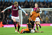 Wolverhampton Wanderers striker (on loan from Bournemouth) Benik Afobe (19) draws a foul from  Aston Villa midfielder Mile Jedinak (15) during the EFL Sky Bet Championship match between Aston Villa and Wolverhampton Wanderers at Villa Park, Birmingham, England on 10 March 2018. Picture by Dennis Goodwin.
