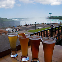 Canada, Ontario, Niagara Falls. Flight of micro-brews at Edgewaters Restaurant overlooking Niagara Falls.