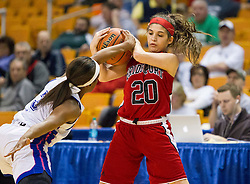Bridgeport guard Gianina Renzelli (20) and Fairmont Senior guard Tyaira Horton (3) tie up a ball during a first round game at the Charleston Civic Center.