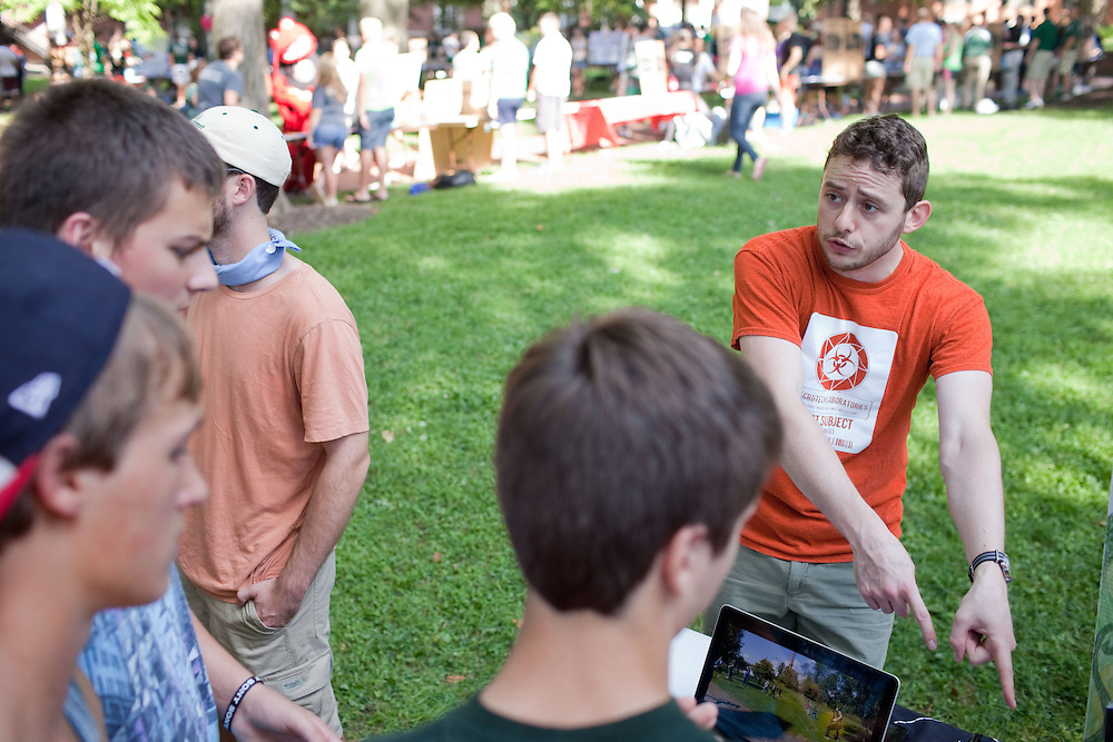 Ben Weibel explains Ohio University's Human vs. Zombies club at the Campus Involvement Fair in Athens, Ohio on Sunday, August 25, 2013. Photo by Chris Franz