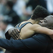 Hodgson Anthony Dominelli celebrates with his coach after defeating William Penn Anthony Rispoli in a 113 pound bout during the Blue Hen Conference Wrestling Tournament Finals Saturday, Feb. 20, 2016 at William Penn High School in New Castle.