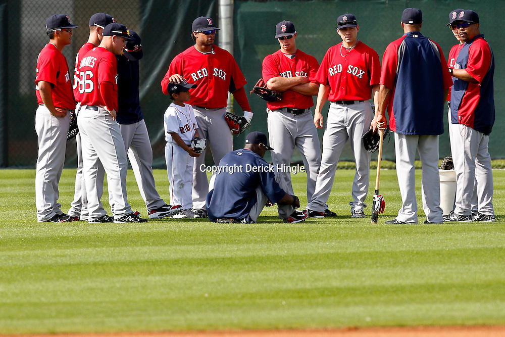 February 17, 2011; Fort Myers, FL, USA; Boston Red Sox outfielders gather during spring training at the Player Development Complex.  Mandatory Credit: Derick E. Hingle