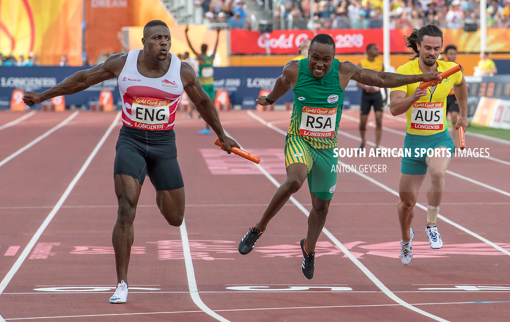 GOLD COAST, AUSTRALIA - APRIL 14: Akina Simbine in action 4x100m Men's relay during on day 10 of the Gold Coast 2018 Commonwealth Games at Carrara Athletics Stadium on April 14, 2018 in Gold Coast, Australia. (Photo by Anton Geyser)