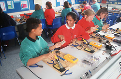 Secondary school pupils in technology lesson,