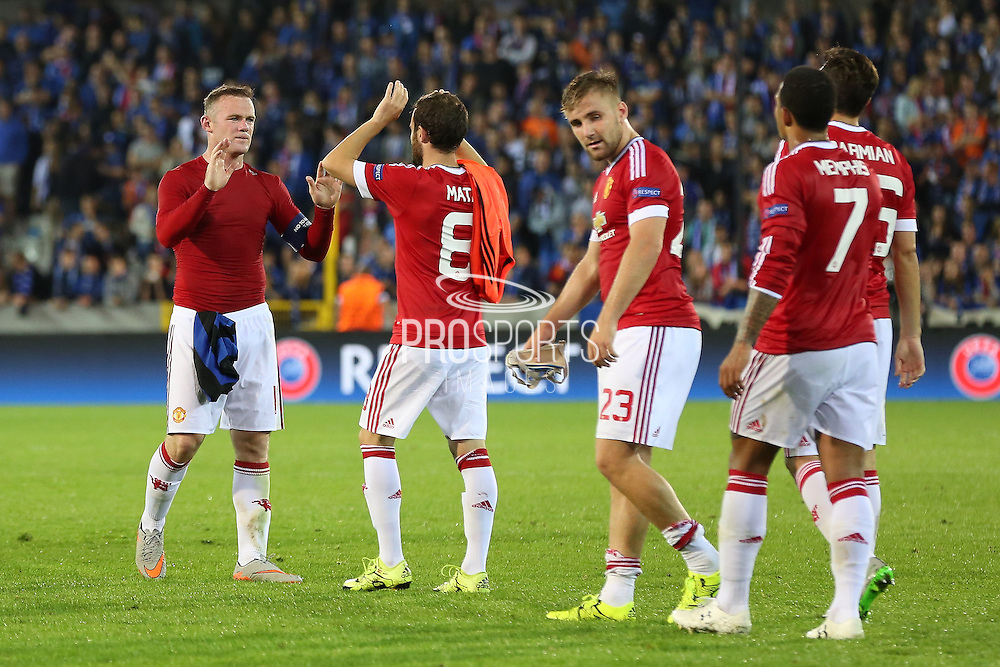 Wayne Rooney of Manchester United congratulates Juan Mata of Manchester United during the Champions League Qualifying Play-Off Round match between Club Brugge and Manchester United at the Jan Breydel Stadion, Brugge, Belguim on 26 August 2015. Photo by Phil Duncan.