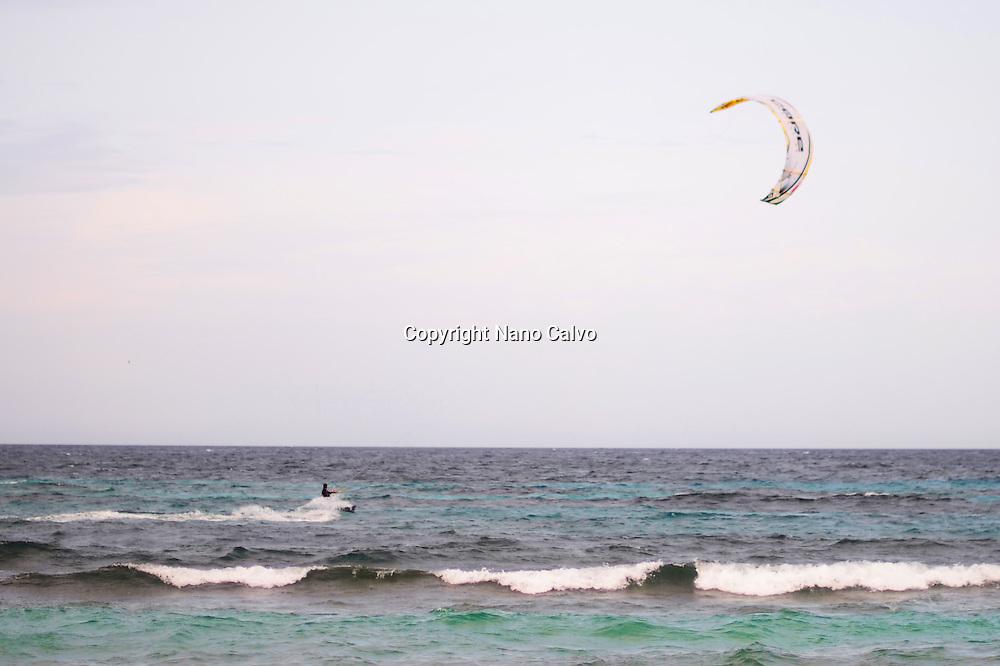 Kitesurfing in Es Cavallet beach, Ibiza, Spain