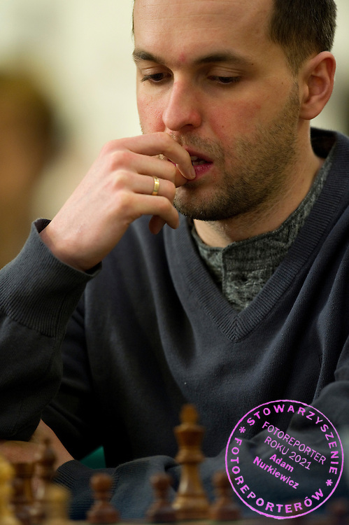 Kamil Miton of Poland plays chess during Chess Polish Championships 2012 at Novotel Hotel in Warsaw on February 21, 2012...Poland, Warsaw, February 21, 2012..Picture also available in RAW (NEF) or TIFF format on special request...For editorial use only. Any commercial or promotional use requires permission...Photo by © Adam Nurkiewicz / Mediasport