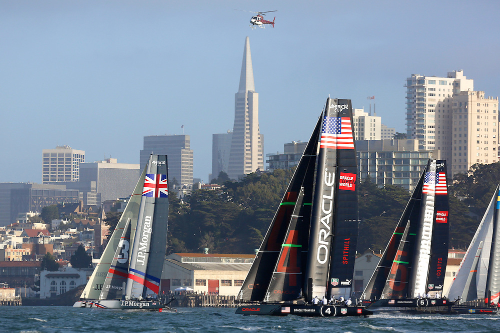 Action from the first fleet race at the America's Cup World Series in San Francisco with the Transamerica tower in the background.  J.P. Morgan BAR wins the heat.Mandatory Credit: Dinno Kovic