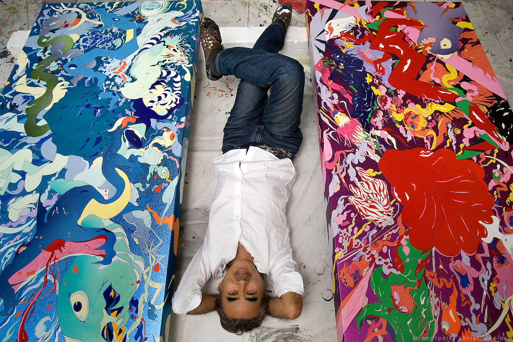YOSHITAKA AMANO - Japanese artist, between two of his paintings in his studio in Tokyo.