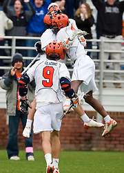 Virginia Cavaliers M Brian Carroll (36) celebrates with Virginia Cavaliers M  Shamel Bratton (1) after scoring the game winning goal in the 7th overtime.  The #9 ranked Maryland Terrapins fell to the #1 ranked Virginia Cavaliers 10 in 7 overtimes in Men's NCAA Lacrosse at Klockner Stadium on the Grounds of the University of Virginia in Charlottesville, VA on March 28, 2009.