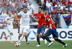 July 1, 2018 - Moscow, Russia - Round of 16 Russia v Spain - FIFA World Cup Russia 2018.Artem Dzyuba (Russia) and Sergi Busquets (Spain) at Luzhniki Stadium in Moscow, Russia on July 1, 2018. (Credit Image: © Matteo Ciambelli/NurPhoto via ZUMA Press)