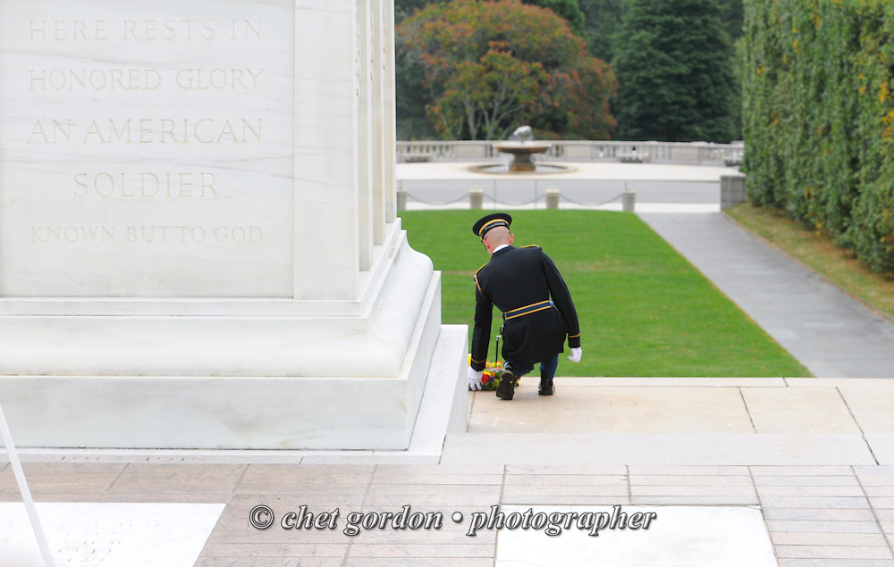 "A sentry with the United States Army's 3rd Infantry Regiment Honor Guard or ""Old Guard"" places a wreath at the Tomb of he Unknowns in Arlington National Cemetery in Arlington, VA on Saturday, September 21, 2013.  © www.chetgordon.com"