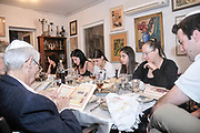 Sedder meal. Family sitting around a table set for a Jewish Festive meal on Passover