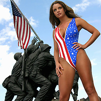 Sexy woman in US flag swimsuit by Iwo Jima Statue