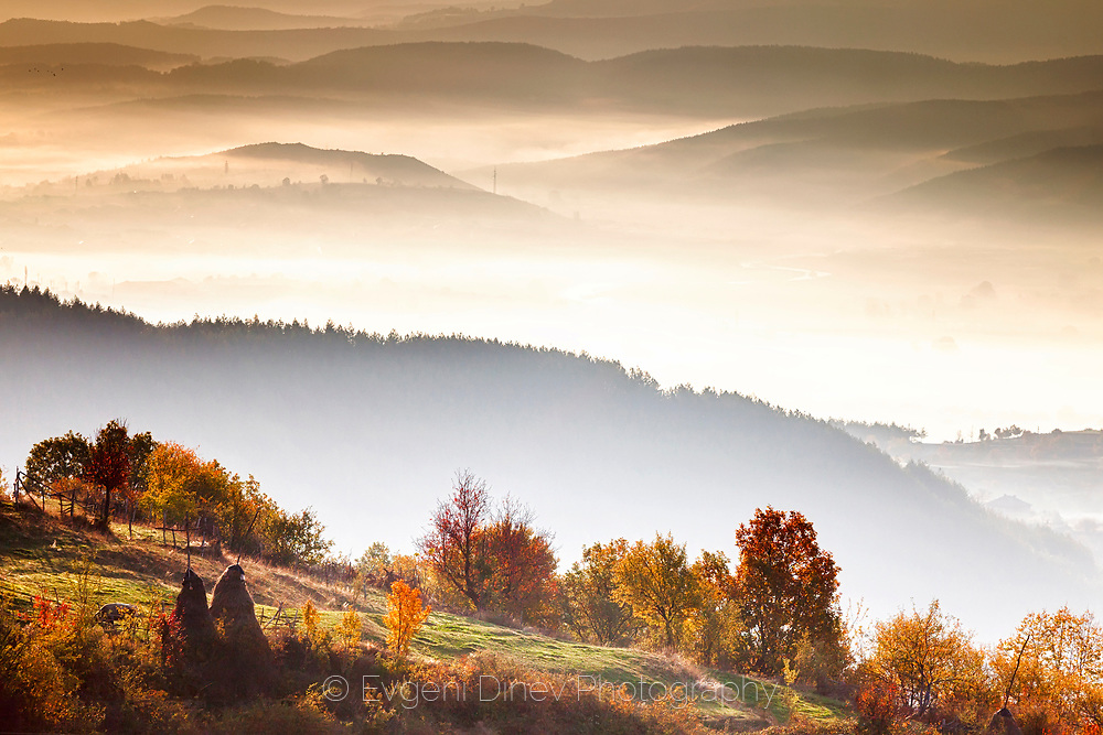 Mountain ridges filled with mist at morning