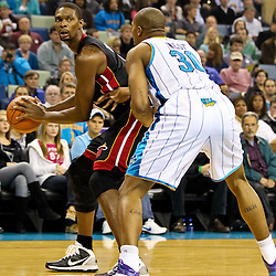 November 5, 2010; New Orleans, LA, USA; Miami Heat power forward Chris Bosh (1) is defended by New Orleans Hornets power forward David West (30) during a game at the New Orleans Arena. The Hornets defeated the Heat 96-93. Mandatory Credit: Derick E. Hingle