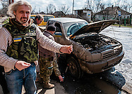 """Valeriy Garagutz - journalist and co-founder of """"Litsa"""" newspaper in Dnipropetrovsk. The pro-Russian administration offer $10 000 US dollars for his head. He is showing me what blow-up the military pickup, a shrapnel from a mortar."""