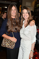 Left to right, ELIZABETH SALTZMAN and EMILY ZAK at a party to celebrate the publication of Cartier's Panthere book at Maison Assouline, Picadilly, London on 7th September 2015