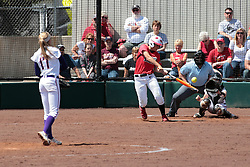 19 April 2014:  Kara Repp bats, Kacey Rogers catches during an NCAA women's softball game between the Evansville Purple Aces and the Illinois State Redbirds on Marian Kneer Field in Normal IL