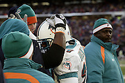 Dolphins defensive back Terrell Buckley is congratulated by teammates after he picked off a pass and ran it back for a 74 yard interception return for a touchdown that was a backbreaker for the Bills during a 20 to 3  win by the Miami Dolphins over the Buffalo Bills in an NFL Week 16 game in Buffalo on December 21, 2003. ©Paul Anthony Spinelli