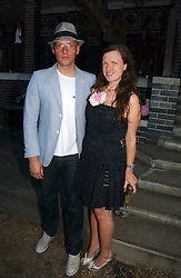 GILES DEACON and KATIE GRAND at a party to celebrate Stephen Jones's 25 Years of Millinery held at Debenham House, 8 Addison Road, London W14 on 13th July 2006.<br />