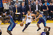 Golden State Warriors guard Stephen Curry (30) attacks the basket against the Charlotte Hornets at Oracle Arena in Oakland, Calif., on February 1, 2017. (Stan Olszewski/Special to S.F. Examiner)
