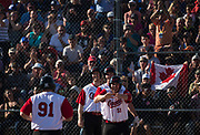 Canada celebrates a grand slam during a game between Canada and Dominican Republic during the 2017 Men's World Softball Championship.