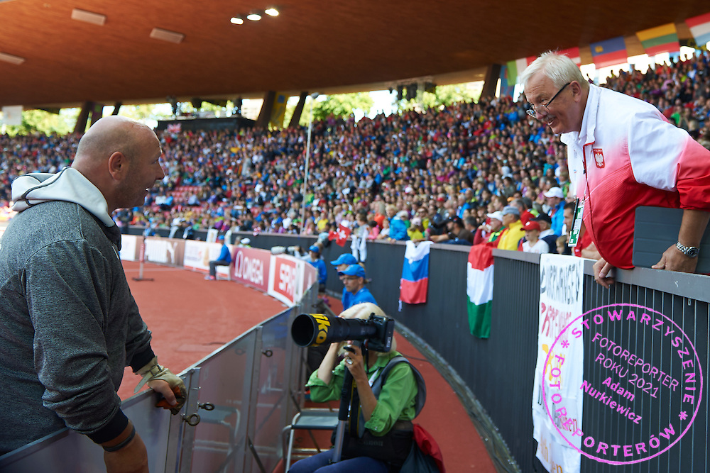 (L) Szymon Ziolkowski of Poland talks with trainer coach Henryk olszewski while men's hammer throw final during the Fifth Day of the European Athletics Championships Zurich 2014 at Letzigrund Stadium in Zurich, Switzerland.<br /> <br /> Switzerland, Zurich, August 16, 2014<br /> <br /> Picture also available in RAW (NEF) or TIFF format on special request.<br /> <br /> For editorial use only. Any commercial or promotional use requires permission.<br /> <br /> Photo by &copy; Adam Nurkiewicz / Mediasport