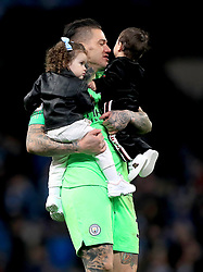 Manchester City goalkeeper Ederson with children after the final whistle