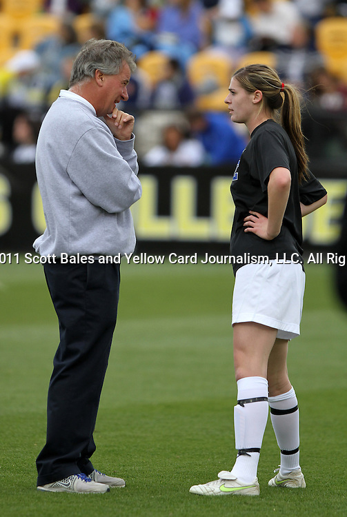 04 December 2011: Duke head coach Robbie Church (left) talks with Kelly Cobb (right) before the game. The Stanford University Cardinal defeated the Duke University Blue Devils 1-0 at KSU Soccer Stadium in Kennesaw, Georgia in the NCAA Division I Women's Soccer College Cup Final.