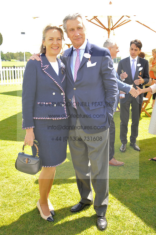 ARNAUD BAMBERGER Executive Chairman of Cartier Ltd and his wife CARLA at the Cartier Queen's Cup Polo Final, Guards Polo Club, Windsor Great Park, Berkshire, on 17th June 2012.