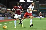 Aston Villa midfielder (on loan from Everton) Yannick Bolasie (11) battles for possession  during the EFL Sky Bet Championship match between Aston Villa and Nottingham Forest at Villa Park, Birmingham, England on 28 November 2018.