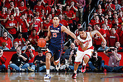 LOUISVILLE, KY - MARCH 7: Malcolm Brogdon #15 of the Virginia Cavaliers dribbles the ball ahead of Quentin Snider #2 of the Louisville Cardinals during the game at KFC Yum! Center on March 7, 2015 in Louisville, Kentucky. Louisville defeated Virginia 59-57. (Photo by Joe Robbins);Quentin Snider