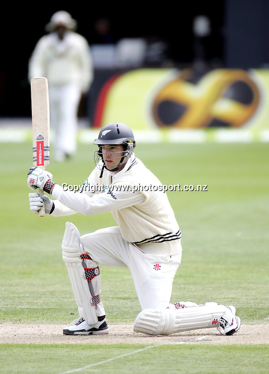 New Zealand batsman Daniel Vettori drives on his way to a score of 63 on day two of the first cricket test match between the New Zealand Black Caps and Sri Lanka at Jade Stadium, Christchurch, New Zealand on Friday 8 December 2006. Photo: Andrew Cornaga/PHOTOSPORT<br />