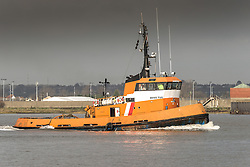 Boss Tug steaming downriver on the River Thames.