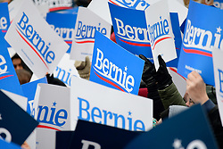 Supporters of Bernie Sanders hold up signs as the Independent US Senator from Vermont kicks-off his campaign for the 2020 U.S. Presidential Elections on a Democratic ticket at a rally at Brooklyn Collage, in Brooklyn, NY on March 2, 2019.