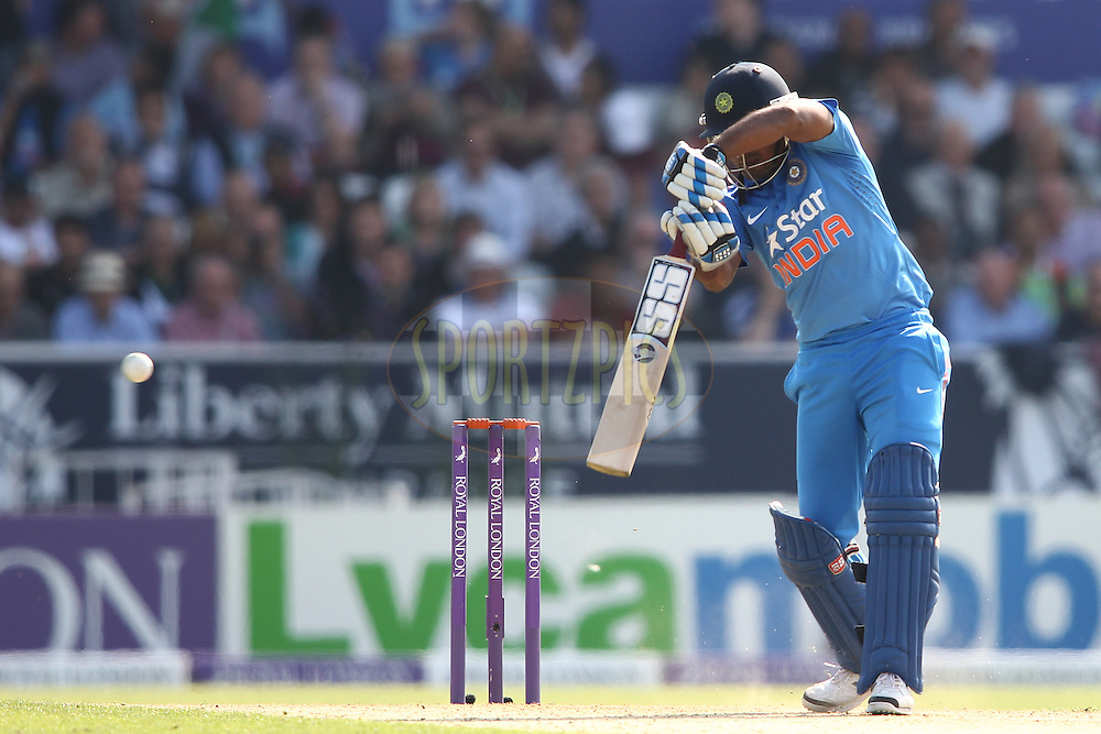 Ambati Rayudu of India drives a delivery behind square during the 5th One Day International ( ODI ) match between England and India held at Headingley Cricket Ground in Leeds, England on the 5th September 2014<br /> <br /> Photo by Shaun Roy / SPORTZPICS/ BCCI