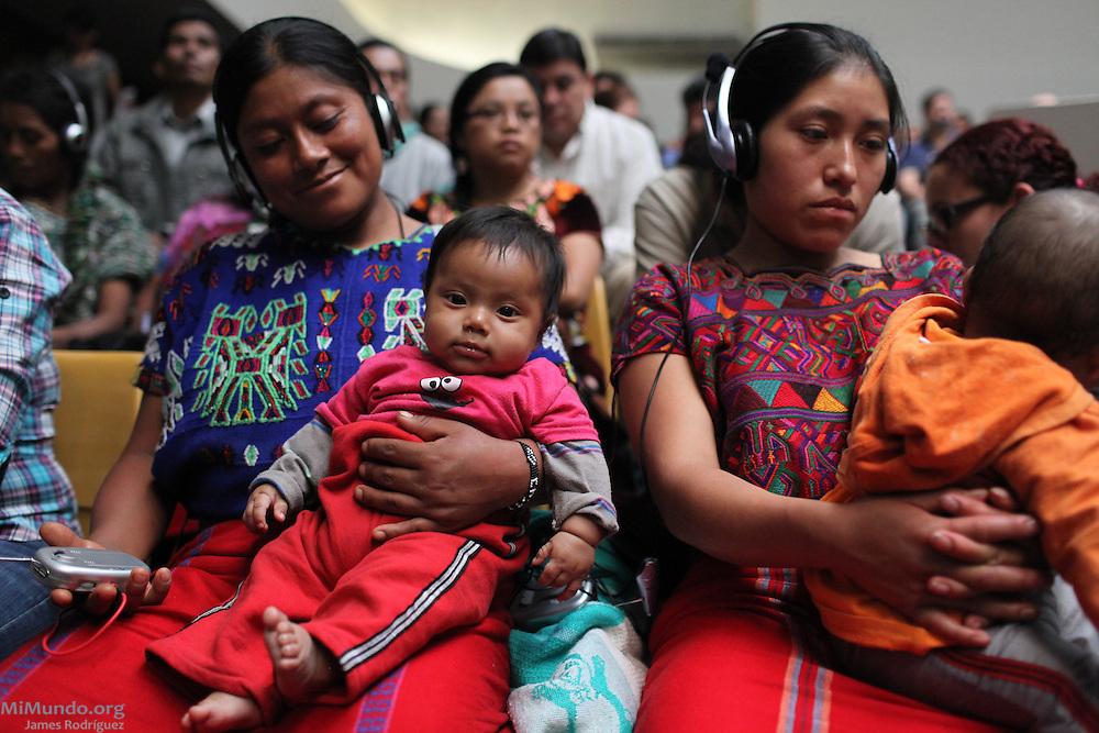 Ixil Mayan women receive radio transmitters for simultaneous translation between Spanish to Ixil. Guatemala City, Guatemala. May 9, 2013.