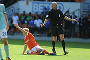 Blackpool Forward, Mark Cullen (9) fouled but Referee Mr L Mason waves play on  during the EFL Sky Bet League 1 match between Blackpool and Accrington Stanley at Bloomfield Road, Blackpool, England on 25 August 2018.
