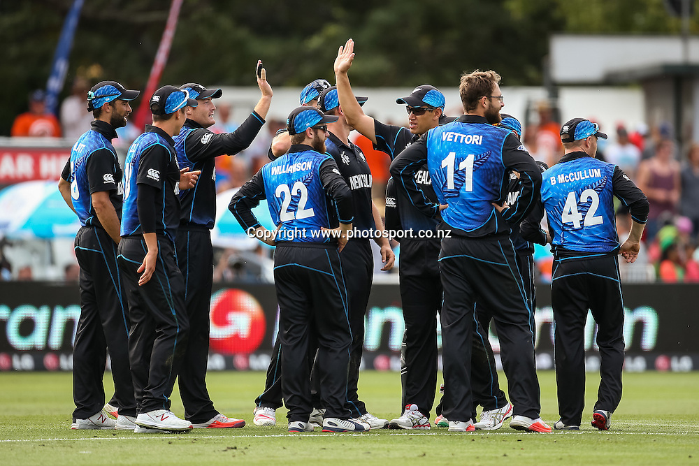 The Black Caps celebrate a wicket during the ICC Cricket World Cup match - New Zealand v Bangladesh played at Seddon Park, Hamilton, New Zealand on Friday 13 March 2015.  Photo:  Bruce Lim / www.photosport.co.nz